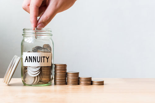 adding coins to a jar labeled annuity to save up money