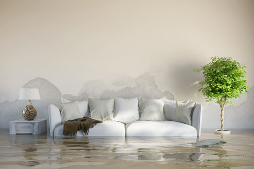 flooded home with couch table and lamp